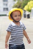 16583539-little-boy-with-a-yellow-helmet