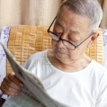 8671613-a-senior-man-is-reading-newspaper